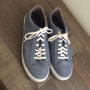 Cole Haan sneakers light blue jeans.